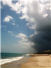 photo of the beach and rain cloud